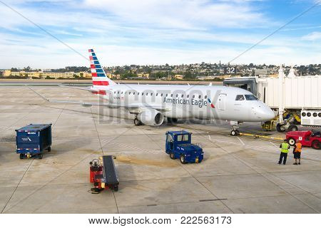 American Eagle Aircraft And Ground Crew On Tarmac