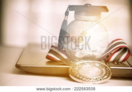 Graduate study abroad concept, Graduation cap on top Earth globe model map Radar background with Medals on laptop. Graduate study abroad program and Back to School and Studies lead success in world