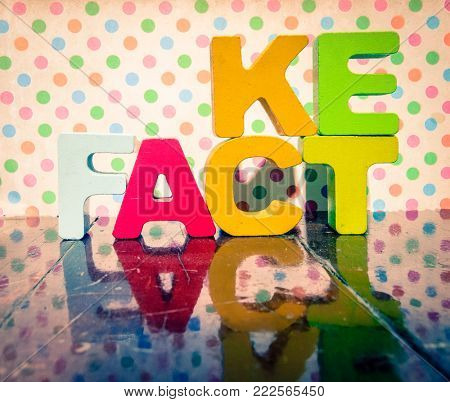 Fact or Fake  wooden letters on old wooden floor
