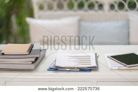 Business Concept.Book and Pile of unfinished documents on office desk.