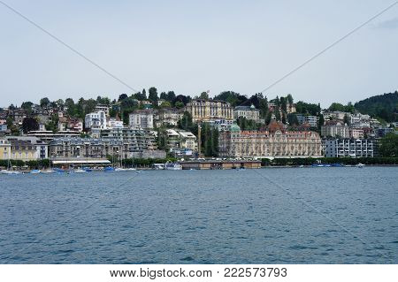 View from the Lake Lucerne on Lucerne, Switzerland; promenade with houses und hotels, photo of the lake,