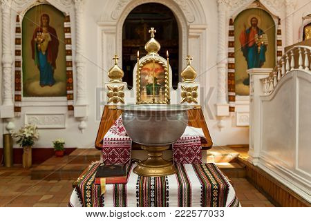Ukraine Kiev on November 14, 2017: Accessories for the christening of children icons of candles and font, Orthodox Church. The Sacrament of Children's Baptism in the Church