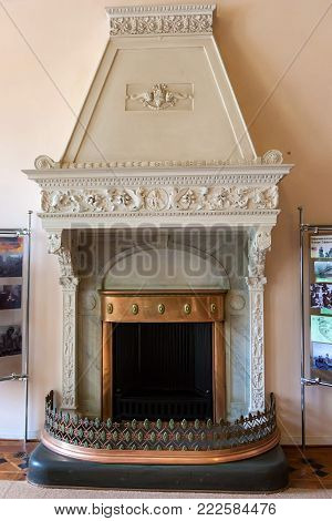 LIVADIYA, CRIMEA - SEPTEMBER 21, 2017: Close up old vintage fireplace in Livadia Palace. The palace was the summer residence of the Russian emperor's family in Crimea