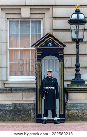 LONDON, UK - NOVEMBER 29, 2017: Queen's Guard at Buckingham Palace. The Queen's Guard is the contingents of infantry and cavalry soldiers charged with guarding the official royal residences.