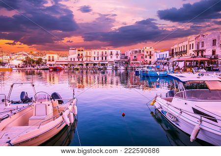 RETHYMNO, CRETE ISLAND, GREECE - JUNE 29, 2016: Stunning sunset over the old venetian port of Rethimnon on Crete island, Greece.