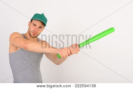 Guy In Grey Tank Top Holds Bright Green Bat.