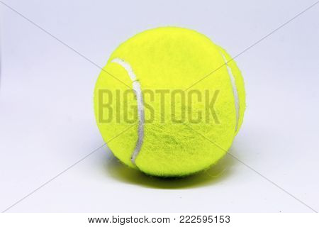 Yellow tennis ball isolated on white background. Tennis ball photo for banner template. Sport equipment isolated. Tennis competition backdrop. Yellow felt ball for active game. Summer sport activity