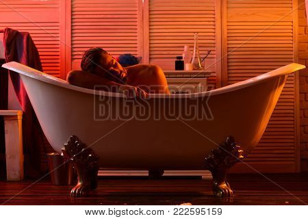 Sex And Relaxation Concept: Guy With Book In Bathtub