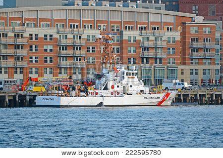 BOSTON - APR. 14, 2015: US Coast Guard Island Class Cutter USCGC Ocracoke WPB-1307 docked at Boston Coast Guard Station in Boston, Massachusetts, USA.