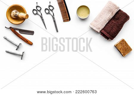 Tools for haircut and shave. Razor, sciccors, brush on white background top view.