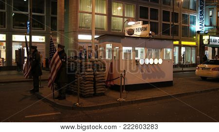 BERLIN, GERMANY - JAN 17th, 2015: Former bordercross checkpoint Charlie in Berlin. It's the best-known Berlin Wall crossing point between East and West Berlin during the Cold War.