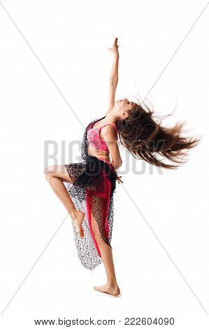 Beautiful girl dancing belly dance in red attire. A dancer performs an oriental tabla dance on a white background. poster