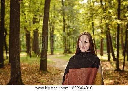 Woman Breathing Fresh Air In A Green Forest In Spring Wearing A Wool Poncho