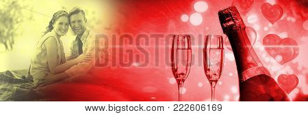 Digital composite of Couple with valentine's love transition hearts and champagne