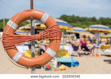 orange rescue tire on a bathing beach - closeup