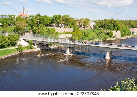 NARVA, ESTONIA: Bridge of Friendship with pedestrian tunnel over Narova River between Narva in Estonia and Ivangorod in Russia. Here is the border of two countries. View from Russia