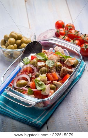 fish salad with swordfish tomatoes and green olives, selective focus