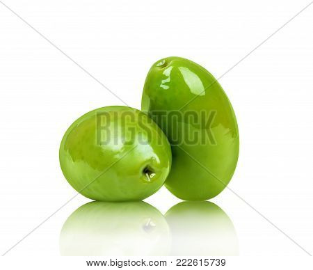 Two green olives closeup isolated on white background