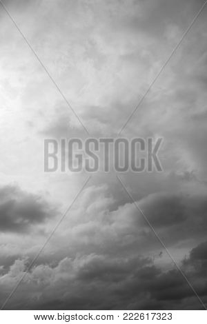 Cloudscape, overcast grey clouds over horizon. Cloudy gray sky background.