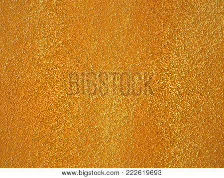 close up of coarse orange wall texture background