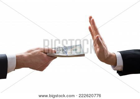 Businessperson's Hand Refusing To Take Bribe From Partner On White Background