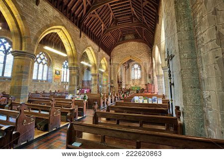 HARBURY, ENGLAND - AUGUST 10, 2012: Interior of the parish church of All Saints in Harbury in Warwickshire, England. It was first built in the Medieval period, but rebuilt and much altered in more recent times.