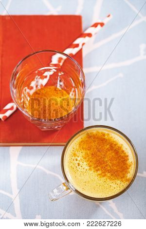 Turmeric latte a golden twist to coffee with spice mix, the drink is made by steaming milk with aromatic turmeric powder and spices