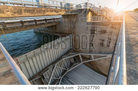 construction of Spillway Dam gate with sunrise, The Pa Sak Cholasit Dam Project is one of the major irrigation projects of Thailand,.