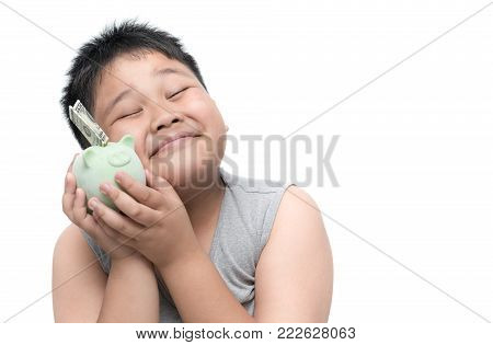 Happy fat boy smile with money and piggy bank isolated on white background, saving and rich concept