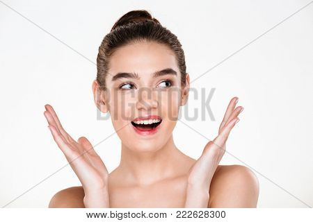 Studio portrait of happy woman with caucasian appearance laughing with perfect teeth, having health skin over white background