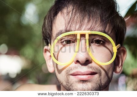 Face Of Young Men Wearing A Strange Glasses