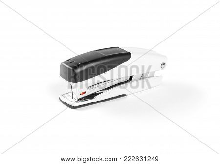 Stapler for paper on white background. Closeup
