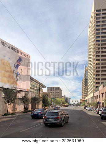 PHOENIX, AZ - DECEMBER 11, 2017: Washington road running west toward Phoenix City Hall in downtown, Arizona
