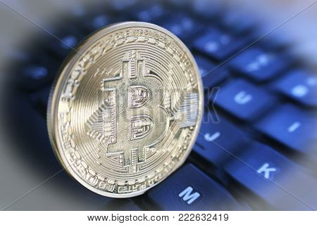 Gold Bitcoin Standing Up On Computer Keyboard With Zoom Burst & White Frame High Quality Stock Photo