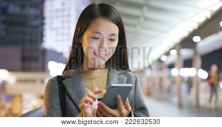 Asian business woman use of smart phone in Hong Kong