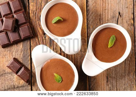 chocolate mousse on wood background