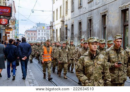 lviv Ukraine - October 30, 2017: Citizens stroll around the scenery with visual agitation on Independence Square on the anniversary of the creation of the Ukrainian army