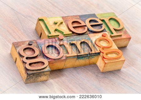 keep going word abstract in letterpress wood type printing blocks