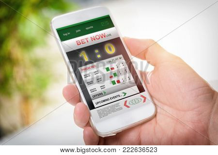 Man betting on sports, holding smart phone with working online betting mobile application poster