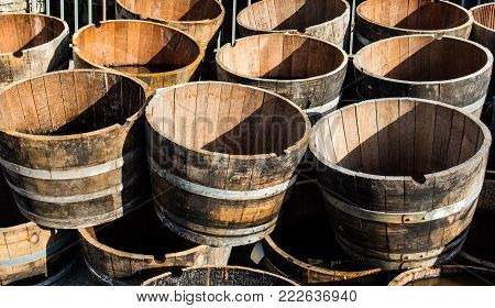 Old Wooden Half Barrels. Ex Wine Casks Having A Second Life To Be Used As Decoration Or As A Flower