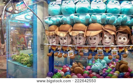 BANGKOK, THAILAND - JANUARY 14: Claw catcher in The Mall Bangkhae displays Disney licensed Sheriff Woody, from Toy Story and James P. Sullivan, from Monsters Inc. on January 14, 2018 in Bangkok.