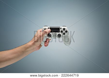 Male Hands Holding Gamepad at studio background