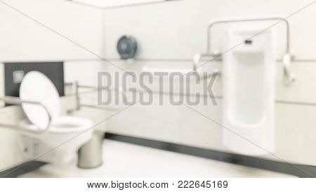 Blur abstract background clean hygienic white lavatory toilet furniture in public WC water closet room for World toilet day concept
