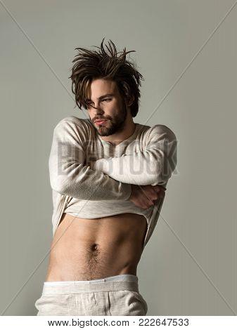 Man With Disheveled Hair In Underwear.