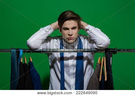 Sport, fitness, health. Sportsman do pull up exercise on rack in wardrobe. Man with muscular torso back on pink background. Fashion, style concept. Shopping, sale, purchase.