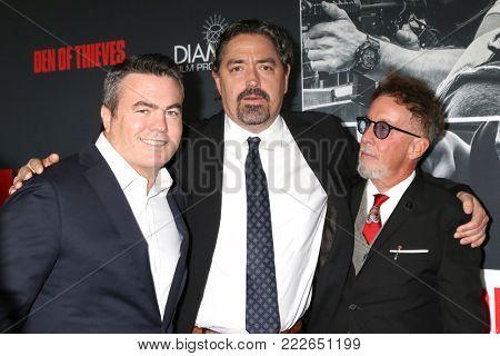 LOS ANGELES - JAN 17:  Tucker Tooley, Christian Gudegast, Mark Canton at the