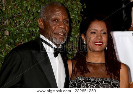 LOS ANGELES - JAN 15:  Danny Glover, Eliane Cavalleiro at the 49th NAACP Image Awards - Arrivals at Pasadena Civic Center on January 15, 2018 in Pasadena, CA