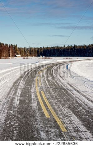 The road has been covered by ice and snow in the rural Finland. In the wintertime the roads can be very slippery.
