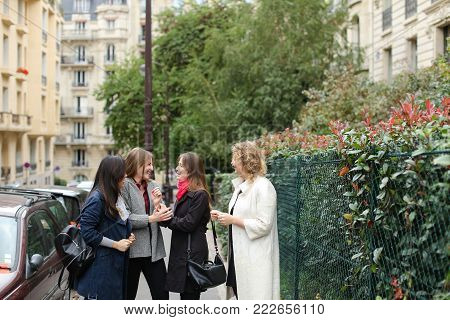 Half Chinese female student telling about studying abroad in   with close up face. Concept of giving interview about educational exchange programs. Beautiful girl with black hair speaking outside.