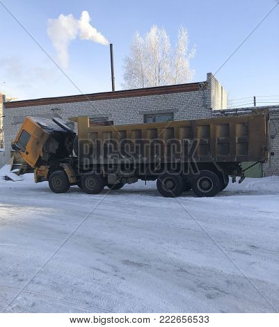 A Large Career Dirty Truck Got Up For Winter Repairs On The Street. The Cabin  Dump Truck Is Pushed